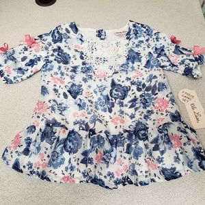 Pullover Top with pink and blue flowers, pink bows